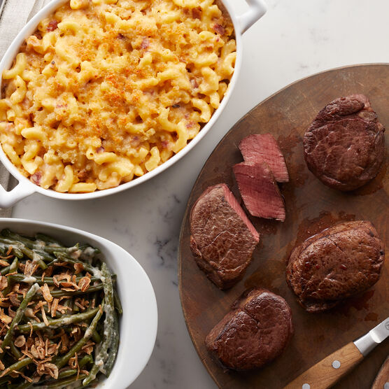 This meal features four 6 oz. Filet Mignon, Green Bean Casserole, and creamy Macaroni & Cheese.