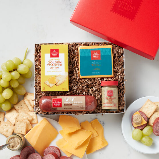 This hearty gift contains 100% Natural Beef Sausage with no added hormones or nitrites, naturally aged Medium Cheddar cheese, Spicy Brown Mustard, and Sea Salt Flatbread Crackers.