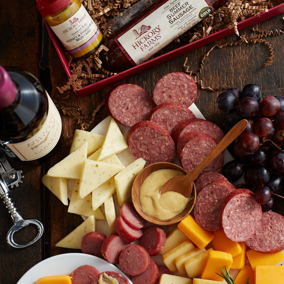 warm and hearty welcome gift box includes summer sausage, cheese, mustard, and various cheeses