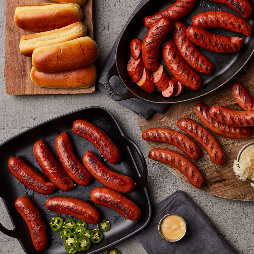 This flight includes zesty Spicy Hot Links, savory Cheesy Pimento Links, and hearty Classic Bratwurst.
