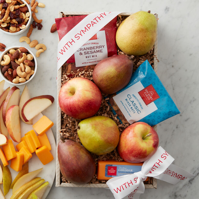 This fruit gift offers a handpicked variety of Hickory Farms' freshest favorites. Included are Crown Comice Pears, an assortment apples, smooth and creamy Farmhouse Cheddar, Cranberry & Sesame Nut Mix, and Classic Nut Mix.
