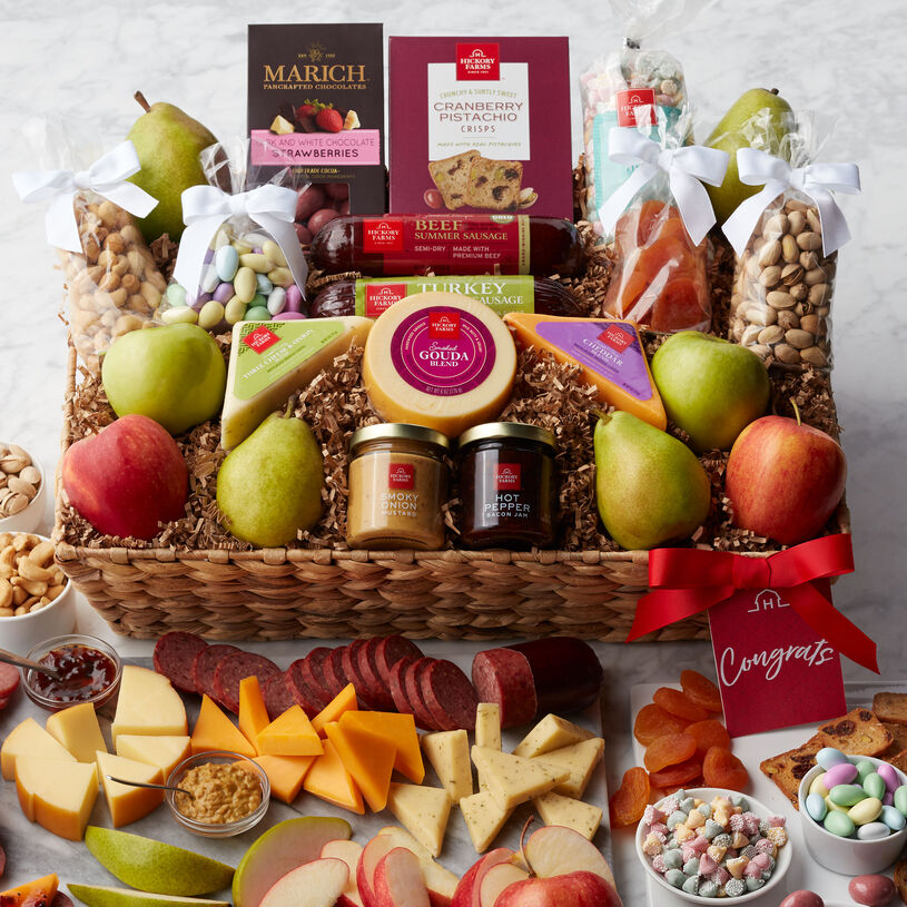 "Say ""congratulations"" deliciously with this bountiful basket filled with sweet and savory treats!"