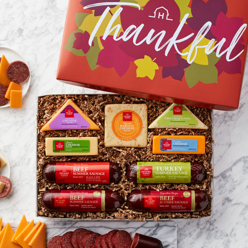 This fall meat and cheese gift features Signature Summer Sausages, Harvest Cheddar Blend, Farmhouse Cheddar, Jalapeño Cheddar Blend, Three Cheese & Onion Blend, and Smooth & Sharp Cheddar Blend.