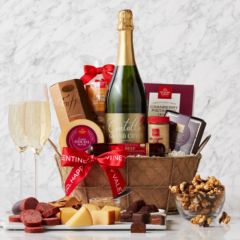 This Valentine's Day gift is filled with beef summer sausage, cheese, mustard, crackers, chocolates, popcorn, and Contollo California Grand Cuvée Sparkling Wine.