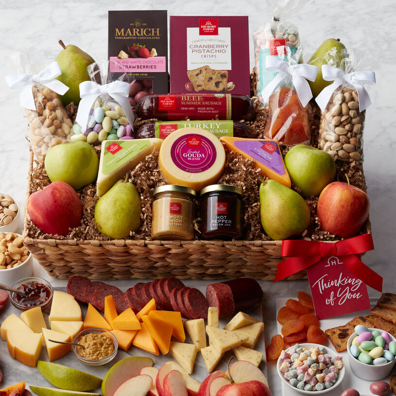 Show someone special you're thinking of them with this bountiful gift basket filled with sweet and savory treats.