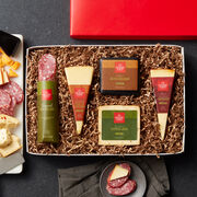 The Gourmet Cheese & Salami Gift Box includes dry salami, smoked garlic cheddar, 3 year aged cheddar, smoked pepper jack, and apple smoked cheddar with paprika