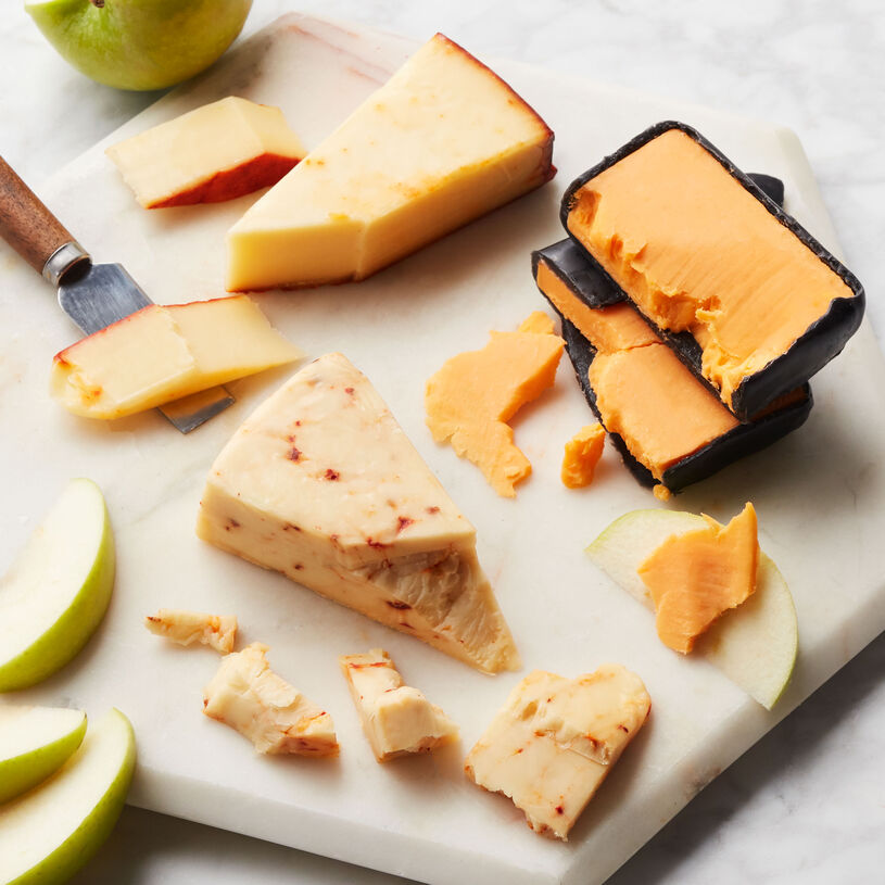 This collection of artisanal cheeses features bold 3-Year Aged Cheddar, creamy Apple Smoked Cheddar, and spicy Chipotle Cheddar.