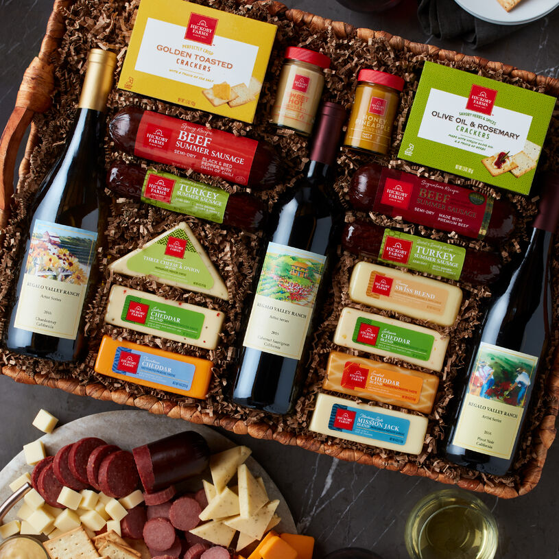 The Hickory Farms Grand Wine Party Gift Basket includes wine, cheese, sausage, crackers, and spreads.