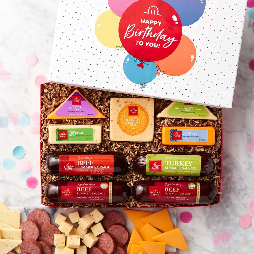This birthday gift box features Signature Beef, Spicy Beef, and Sweet & Smoky Turkey Summer Sausages and a variety of cheeses.
