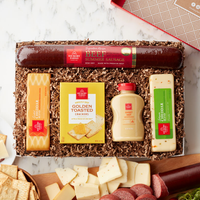 This gift is packed with Hickory Farms favorites: Signature Beef Summer Sausage, Smoked Cheddar and Jalapeño Cheddar Blend cheeses, Sweet Hot Mustard, and Golden Toasted Crackers to stack up a timeless snack.