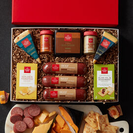 This gift box includes natural summer sausage, cheeses, mustard, and crackers.