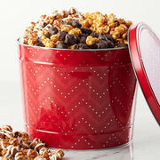 Premium Caramel Corn with Nuts, White Chocolate Snickerdoodle, and Dark Chocolate Sea Salt Caramel are beautifully packed in a festive red tin.