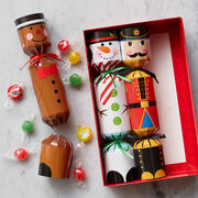 With cute gingerbread man, snowman, and nutcracker designed, these poppers will be a big hit with the kids at any holiday gathering.