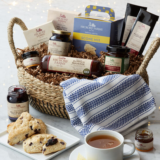 This basket features sweet and savory flavors for creating a delicious brunch spread right at home, like fruit preserves, scone mix, tea, honey, coffee, sausage, and cheese.
