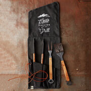 This handsome black canvas roll holds three essential tools for grilling with ease! All crafted from heavy-duty stainless steel with carved wood handles, this set features tongs, spatula, and fork.