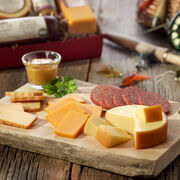 gift box includes summer sausage, various cheeses, and mustards
