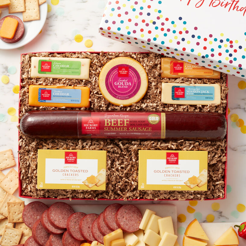 This birthday confetti gift box is filled with our party-size Signature Beef Summer Sausage, Smoked Gouda, Smoked Cheddar, Jalapeño Cheddar Blend, Farmhouse Cheddar, Mission Jack Blend, and Golden Toasted Crackers.