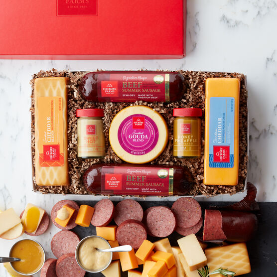 Our best-selling gift box includes mustard, summer sausage, and various cheeses
