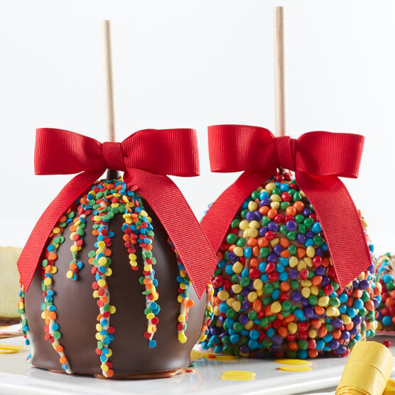 Caramel apples with birthday frosting and confetti sprinkles