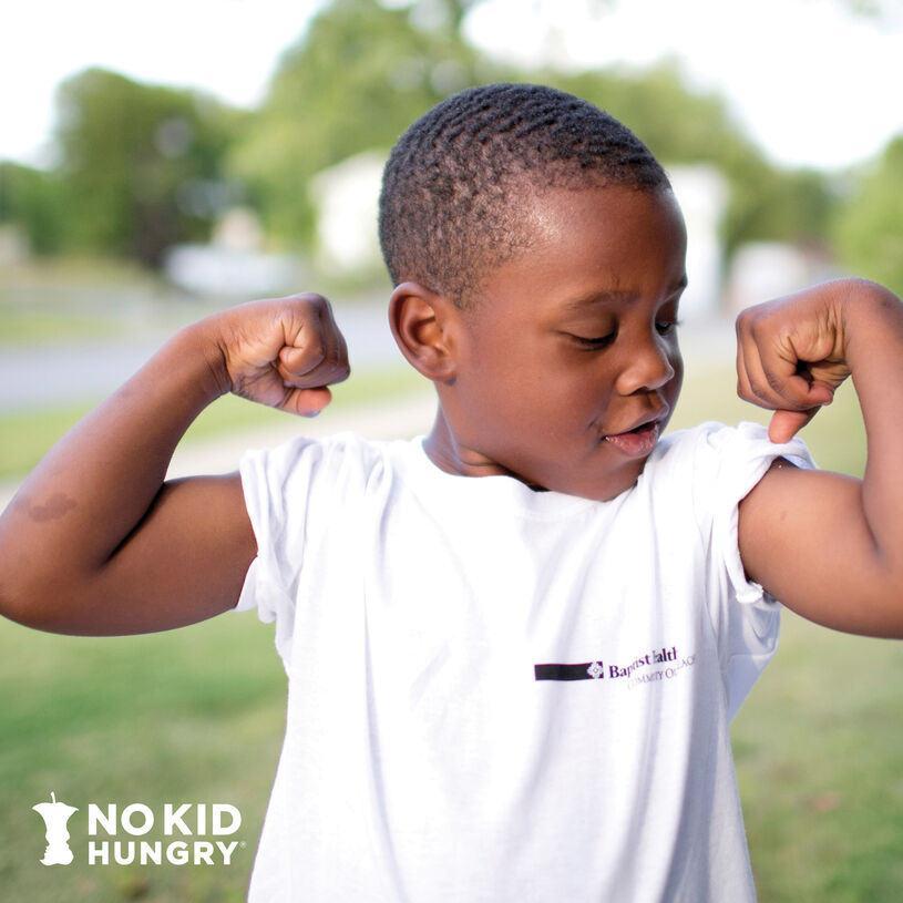 No Kid Hungry Boy flexing muscles smiling