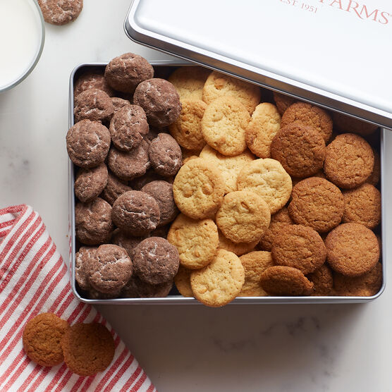 This festive cookie collection features spiced Ginger Snap cookies, Triple Chocolate cookies, and Salted Caramel Chip cookies.