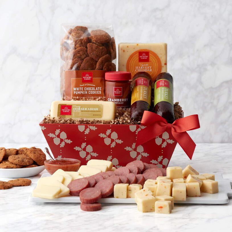This gift basket is filled with harvest flavors like Turkey Summer Sausages, Harvest Cheddar Blend, Mission Jack Blend, Cranberry Mustard, and Pumpkin Cookies.