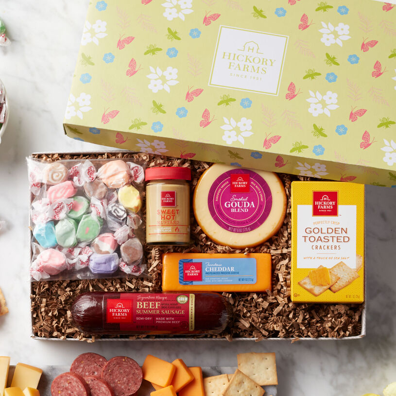 This spring gift is filled with Beef Summer Sausage, Farmhouse Cheddar, Smoked Gouda Blend, Sweet Hot Mustard, Golden Toasted Crackers, and taffy.