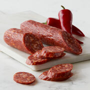 Our Three Pepper Dry Salami is made with spicy white, cayenne, and crushed red peppers, before being cured by a master Salumiere for a full-bodied flavor that builds in heat with each wonderful bite.