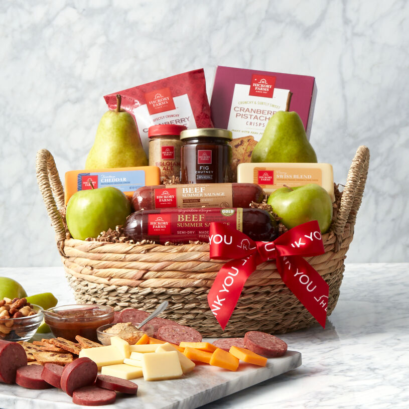 This Thank You Gift Basket features our Beef and All-Natural Beef Summer Sausages, cheese, mustard, Fig Chutney, crackers, pears, and apples.