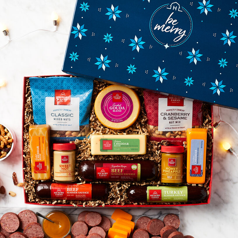 The Be Merry Give Back Gift Box features our signature designed box filled with an assortment of our award-winning sausages and cheeses.