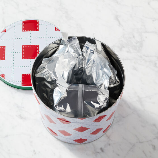 Bags of popcorn within the tin.