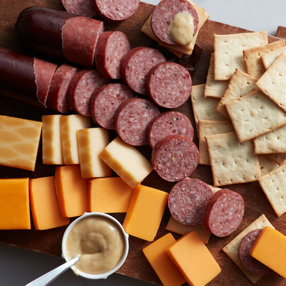 Alternate view of gift box that includes crackers, mustard, summer sausage, and cheeses