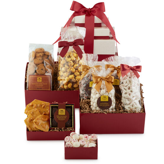 This gift features four boxes packed with sweets, treats, and candies that are sure to brighten anyone's day.