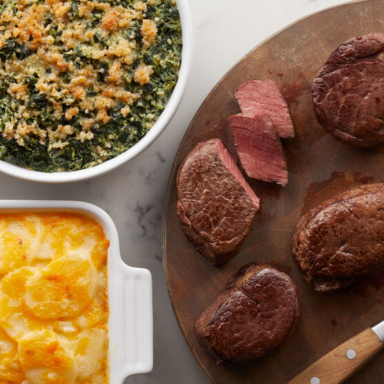A gourmet dinner to impress with four 6 oz Filet Mignon, Green Bean Casserole, Three Cheese Scalloped Potatoes, and decadent Marble Ganache Cheesecake.