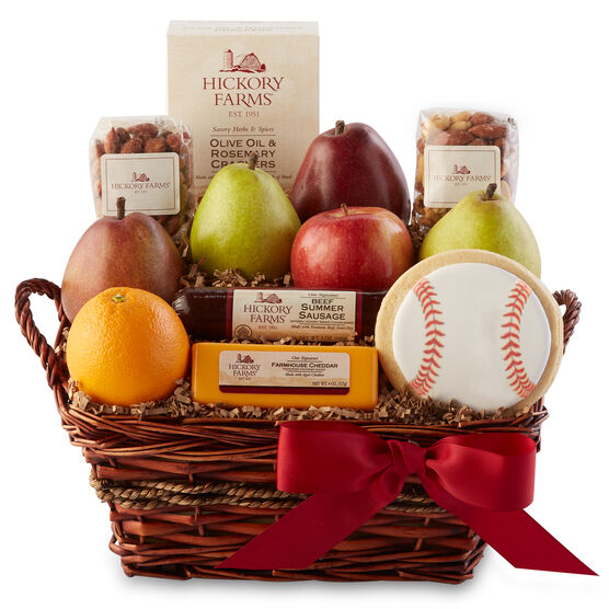 This gift basket includes luscious fresh fruits, savory cheese and mixed nuts along with a festive baseball cookie
