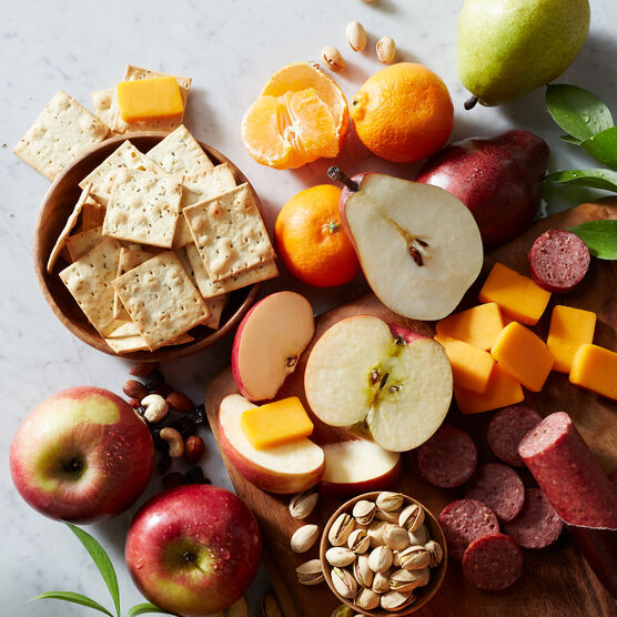 Gift Basket includes sausage, cheese, mixed nuts, crackers, and fruit