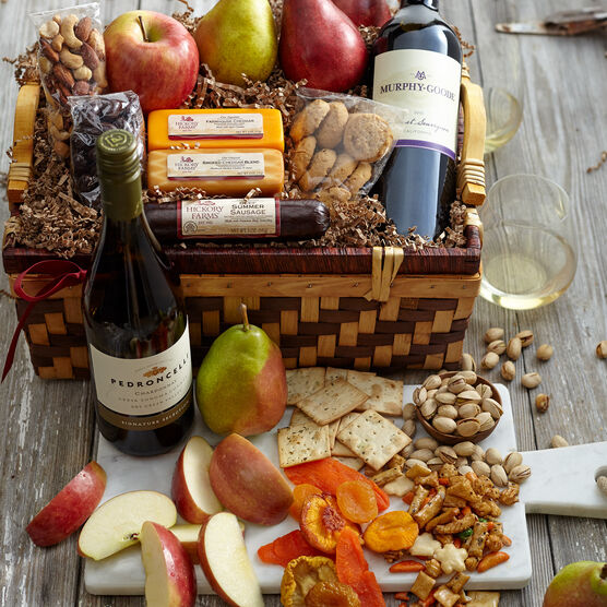 Hickory Holiday Celebration Gift Basket includes summer sausage, cheese, mixed nuts, and dried fruit
