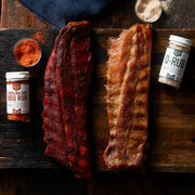 Dad will be able to customize his perfect rack of ribs with this delicious gift! It includes two racks of our Premium Pork Ribs that he can season to perfection with Carolina Dirt and Q Rubs from barbeque legend Lillie's Q.