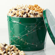 Premium Caramel Corn, Sweet & Salty Kettle Corn, and chocolatey Black & White Kettle Corn, all packed in a festive holiday tin.