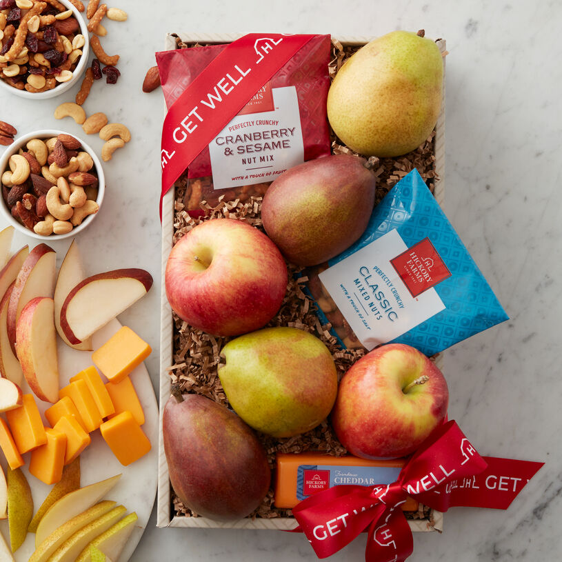 This fruit gift includes Crown Comice Pears, an assortment apples, smooth and creamy Farmhouse Cheddar, Cranberry & Sesame Nut Mix, and Classic Nut Mix.