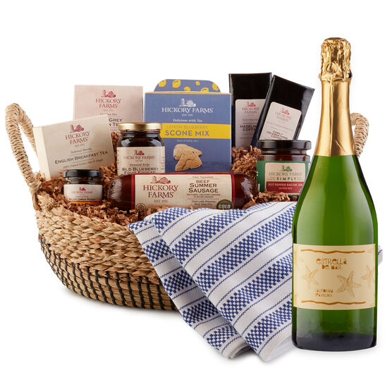 This gift features sweet and savory essentials for creating a delicious brunch spread right at home, carefully packed in a chic reusable basket.