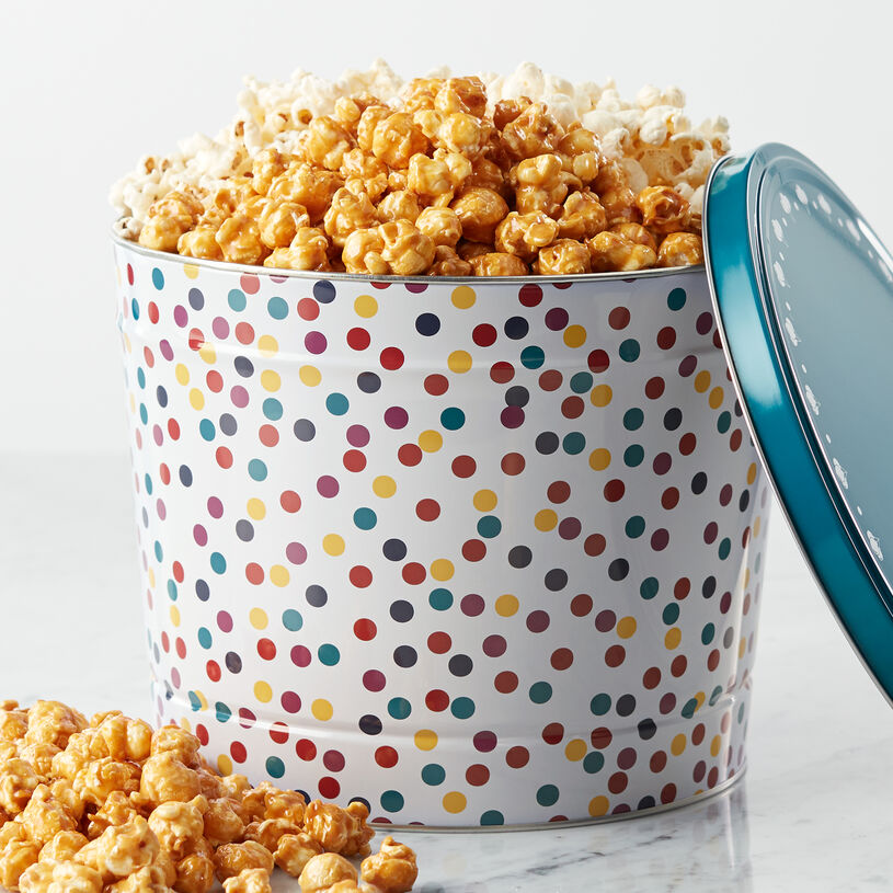 This tin is packed with a delectable sampling of Sweet & Salty Kettle Corn, Premium Caramel Corn, and White Cheddar Popcorn that's perfect for sharing.