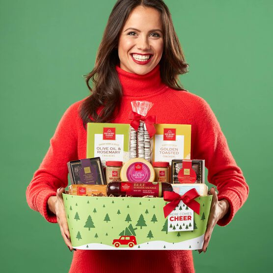 Here Comes Cheer Holiday Gift Basket Held by Woman