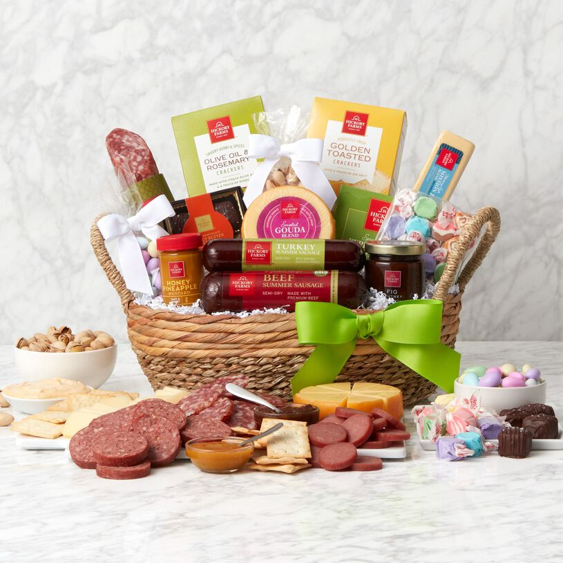 This Deluxe Spring Snack Basket includes beef summer sausage, cheese, crackers, taffy, and Jordan almonds.