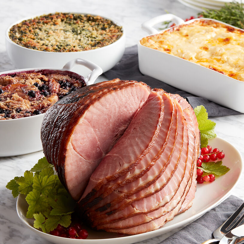 Thiis gourmet meal includes our HoneyGold Spiral Sliced Ham, Three-Cheese Scalloped Potatoes, Parmesan Creamed Spinach, and Blueberry Peach Crisp.