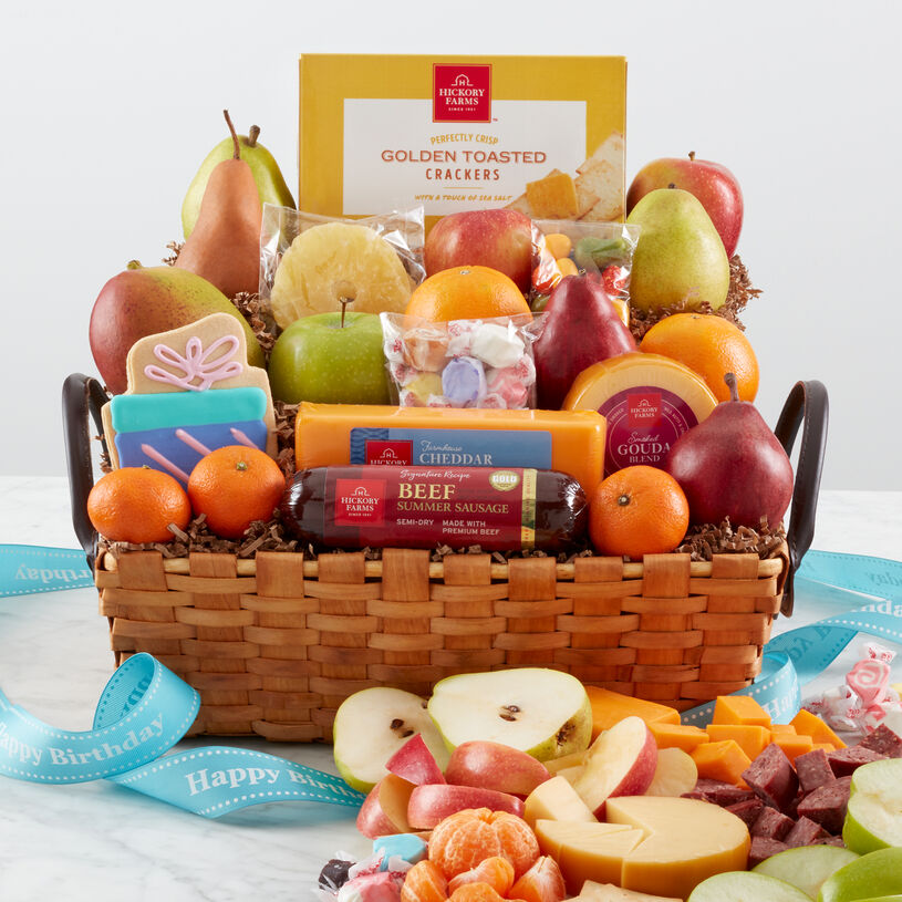 Happy Birthday Gift Basket with a variety of fruit, summer sausage, cheese, and candy