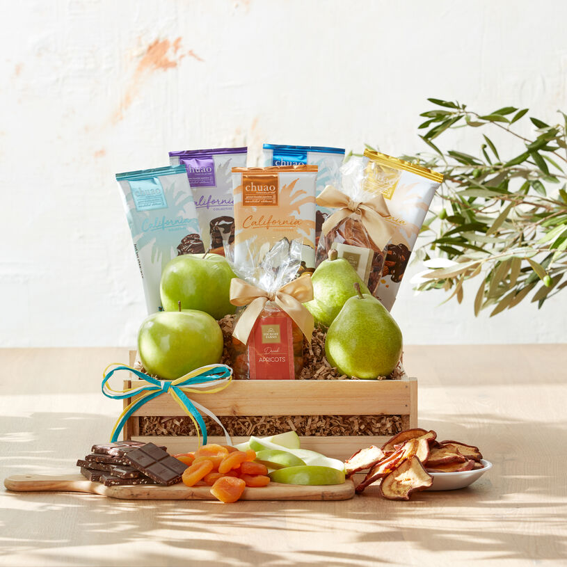 This crate is filled with Comice Pears and green apples, dried fruit, nuts, and five sweet flavors from Southern California's Chuao Chocolatier.
