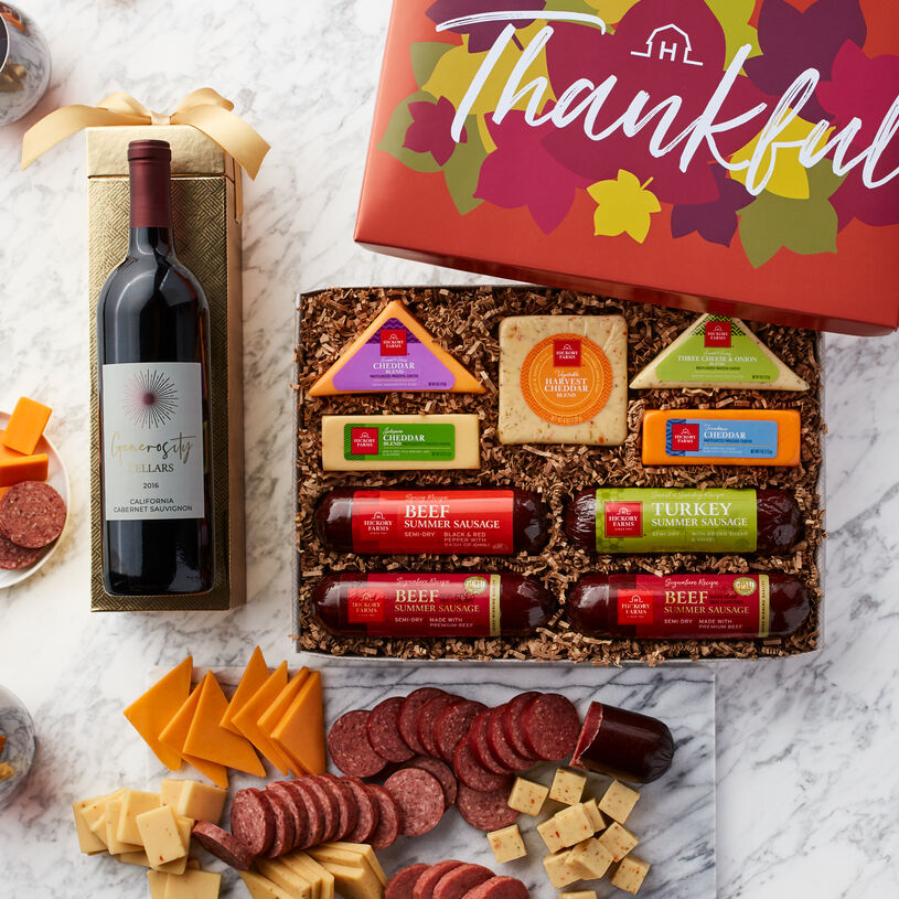 Send a fall gift box that can help them make the perfect meat and cheese spread, complete with wine!