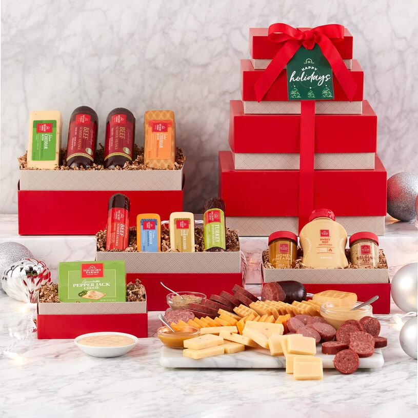 This holiday tower includes Signature Beef Summer Sausage, Turkey and Spicy Summer Sausages, Horseradish Cheese, and Farmhouse Cheddar, and spreadable cheese.