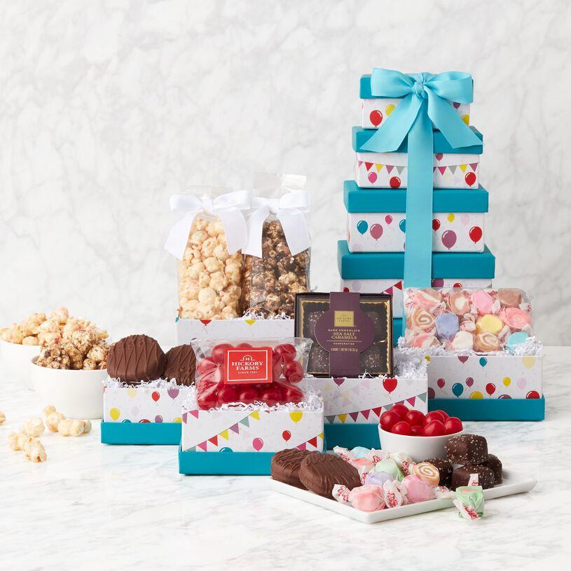 Dark Chocolate Sea Salt Caramels, Cherry Sours, Cookies & Cream and Birthday Cake Popcorn, Mini Meltaway Mints, and Milk Chocolate and White Chocolate Sandwich Cookies.